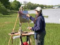 Rosalie Nadeau painting an oil painting en plein air, with her Take It Easel. Rosalie Nadeau says the Take It Easel is the best plain air easel.