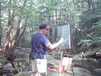 Bernie Ethier paints a large oil painting at his Take It Easel en plein air.  The Take it easel supports his artwork and all his art supplies.