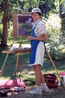 Joan Ledwith paints a large pastel painting on her Take It Easel en plein air.  The Take It Easel supports her artwork and all her art supplies.