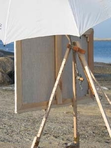 How to attach an umbrella to an art easel, showing a close up rear view, on the Take It Easel portable art easel supporting a large plein air painting