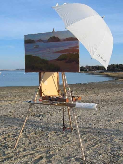 How to attach an umbrella to an art easel, shown from the front, on the Take It Easel portable art easel supporting a large plein air painting